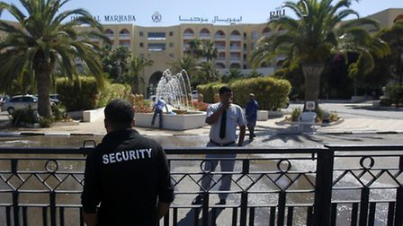 A security officer guards the entrance to the Imperial Marhaba hotel which was attacked on Friday in