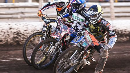 Things get tight between Ashley Morris (yellow helmet), Ritchie Hawkins (blue) and Claus Vissing as