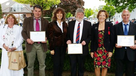 Managers and staff from the Boxford Group following the long service presentation at the Suffolk Sho