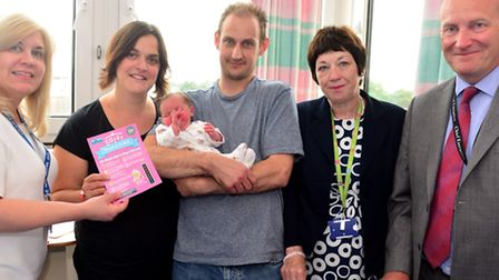 Emma Hardwick Head of Mid-Wifery (L to R) Jane and James Gardiner with baby Ella, Sally Hogg and Ips