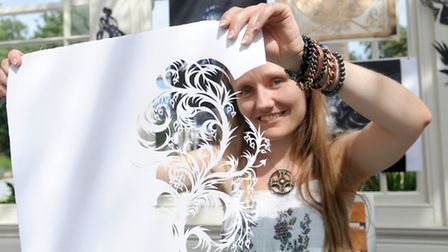 Lois Cordelia demonstrates her paper cut art at at Holywells Park in Ipswich.