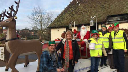 Diss Waveney Rotary club bring Santa to the Mere's Mouth in Diss on Christmas Eve. Pictured: Pat and