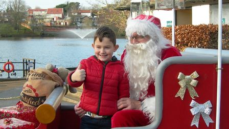 Children enjoy a visit from Santa Claus to Diss by Diss Waveney Rotary club on Christmas Eve. PHOTO: