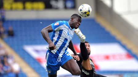 Ex-U's skipper Magnus Okuonghae, in action against Peterborough, has joined Luton Town on a two-year