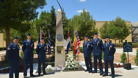 U.S. Air Force Airmen and Spanish Cross of Aeronautical Merit recipients pose for a group photo in f