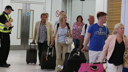 Passengers arrived back at Glasgow Airport after returning on a flight from Tunisia - holidaymakers
