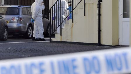 Police examining a scene in Clacton the day after the murder.