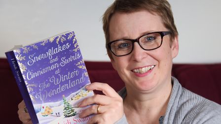 Best selling author Heidi Swain with her new Christmas themed book, Snowflakes and Cinnamon Swirls a