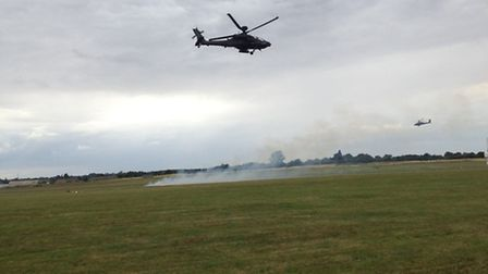 Apache Attack Helicopters performing a flying demonstration at Wattisham Air Base as part of familie