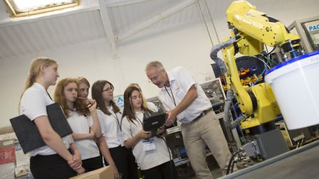 Visiting school students get to grips with robotics controls at Pacepacker.