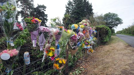 Floral tributes are left at the scene of an accident in Worlington.
