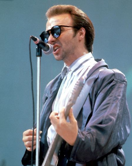 Midge Ure performing at Live Aid with Ultravox