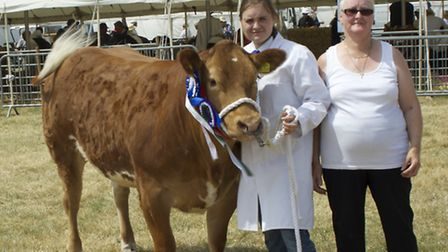 Rita Parker, granddaughter Jade Lanham, and Limousin cross Holly, which took the supreme beast title
