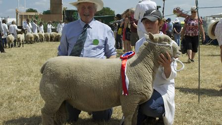 Judge Peter Rycraft and owner Amy Readhead-Higgins of Leiston with her winning Southdown sheep.