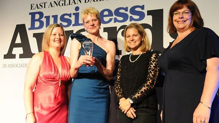 Melissa Abbott and Mary Narey of Muntons receive the firm's Business of the Year trophy from Sarah H