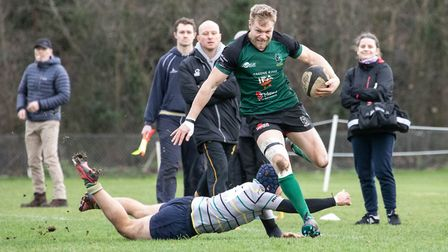 Jim Riley evades a tackle as North Walsham gained the upper hand against Old Priorians in London Pic