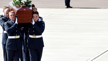 The coffin of Stuart Cullen is carried from the RAF C-17 at RAF Brize Norton in Oxfordshire.