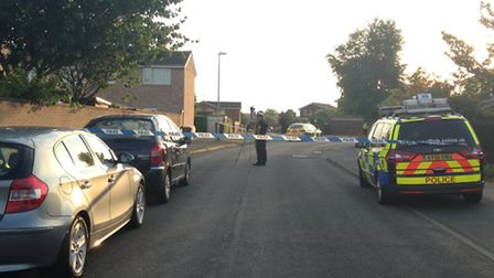 Police in Chatsworth Drive, Rushmere St Andrew, after teenager was flown to Addenbrooke's