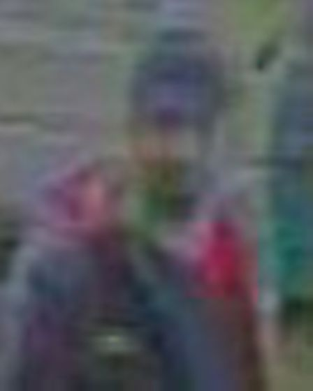 Police are looking to trace three people they want to speak to in connection with the theft of a wom