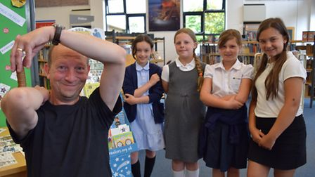 Dean Gould with youngsters from Langer Primary Academy at the launch of the Summer Reading Challenge