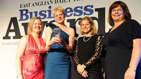 Melissa Abbott and Mary Narey of Muntons receive the Business of the Year trophy from Amber Brinkley