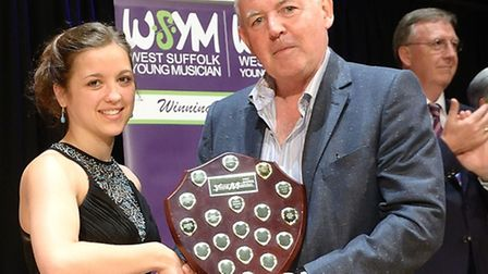 Liliana Luongo was presented with music vouchers and the winner's shield by John Balaam, of Balaam's
