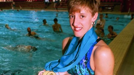 Ipswich swimmer Karen Pickering at the towns Crown Pools with the medals she won at the Commonwealt