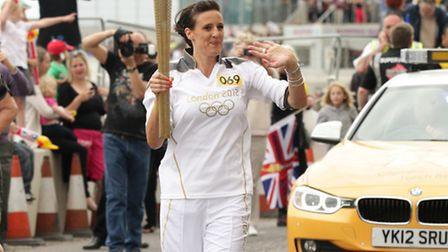 Olympic Swimmer Karen Pickering carries the Olympic Flame on the Torch Relay leg through Margate