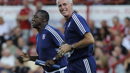 Mick McCarthy and Terry Connor jog back to the dugouts for the second half at Brentford. Photo: PAGE