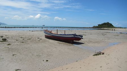 The idyllic beach at the Imperial Boat House Resort, in Choeng Mon