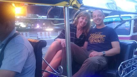 Camille and her husband David settle into their tuk tuk during the Bangkok Night Lights tour, booked