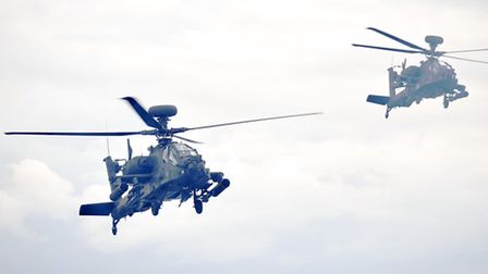 Apache helicopters, here performing manoeuvres with a pyrotechnic display at Wattisham's Family Day,