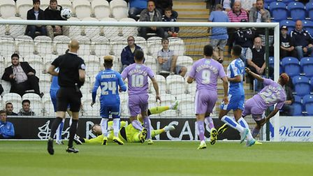 Sam Walker makes an early block on his return for the U's against Reading tonight. But he was stretc