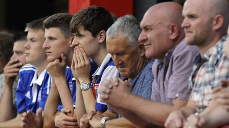 Town fans watch anxiously and check their watches while the score stood at 2-1 at Brentford.