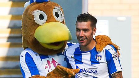 Darren Ambrose celebrates with Colchester mascot Eddie the Eagle after scoring the U's second during