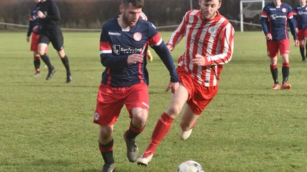 Action from Norwich CEYMS' 2-2 draw with Wymondham Town. Picture: Sonya Duncan
