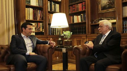 Greek Prime Minister Alexis Tsipras , left, speaks with Greek President Prokopis Pavlopoulos, durin