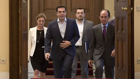 Greek Prime Minister Alexis Tsipras, second from right, arrives for a Greek political leaders meetin