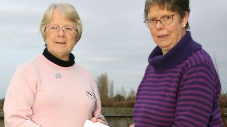 Caroline Walker of the Diss and Eye Parkinsons support group is presented with £400 by Pat Mordey, o