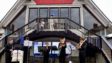 A 5 piece brass band plays outside the lifeboat station at Aldeburgh on the second day of the town's