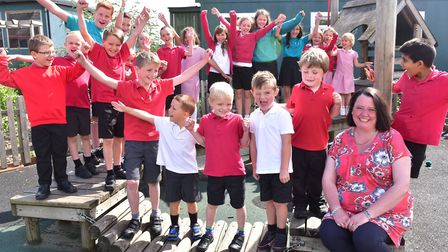 Headteacher Sarah Bradford with pupils at Roydon Primary School, which has retauined its good Ofsted