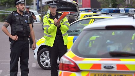 Police attend the scene of a shooting near the train station in Bury St Edmunds