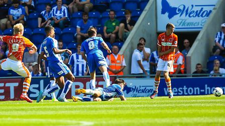 Mark Cullen (9) fires home for Blackpools second in the Colchester United v Blackpool match at the W