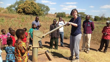 Northumbrian Water chief executive Heidi Mottram testing out a village water pump in Malawi during h