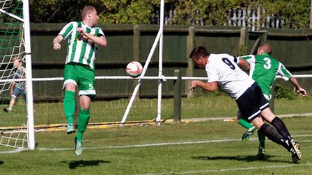 Swaffham's Jack Defty heads the only goal of the game against Whitton