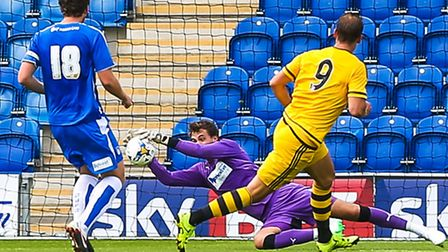 Sam Walker makes a fine save during the closing minutes of the pre-season friendly against Fulham la