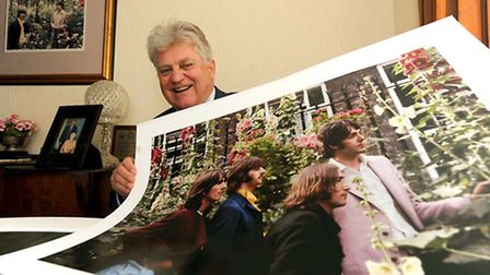 Tom Murray is pictured with one of his photographs of the Beatles which has been sold for �15,000 wh