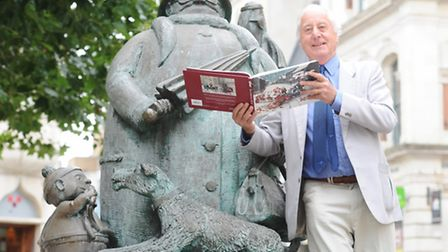 John Field with the new cartoon collection, at the statue of Grandma & co at Giles Circus in Ipswich