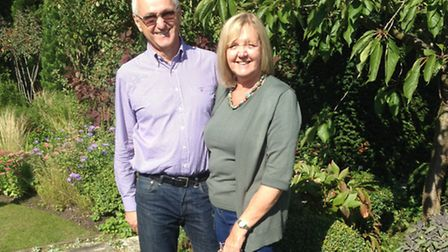 Neil and Linda Holdaway in their English cottage garden