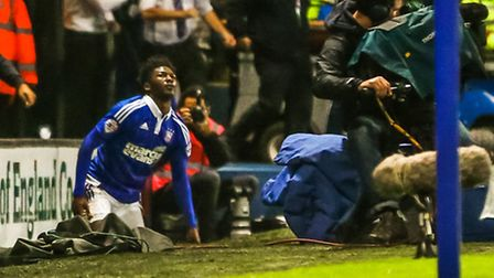 Ainsley Maitland-Niles ends up near the advertising hoardings after a foul during the Ipswich Town v